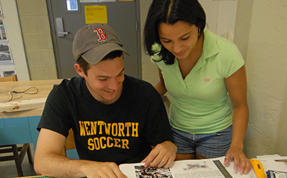 Photo of two students reading a book. Link to Gifts That Pay Income.